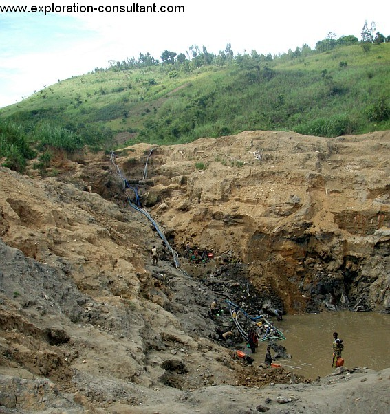 Constant dewatering of the pit is necessary, not too seldom the walls collapse and bury the gold miners.